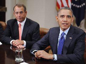 Barack Obama und John Boehner können sich bislang nicht einigen.