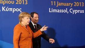 Zypern von Moody's herabgestuft: Merkel mahnt zu Reformen