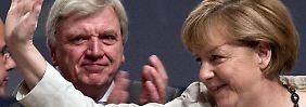 Bouffier könnte von Merkels Popularität profitieren.