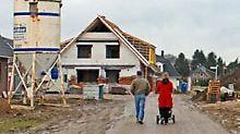 Mit einer Garantieklausel im Darlehensvertrag können sich Bauherren schützen.